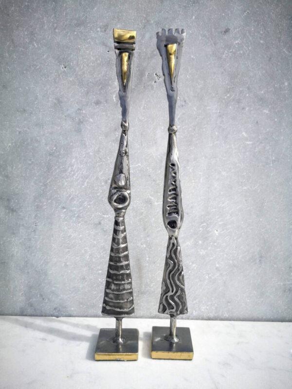 Polished steel & brass figure sculpture