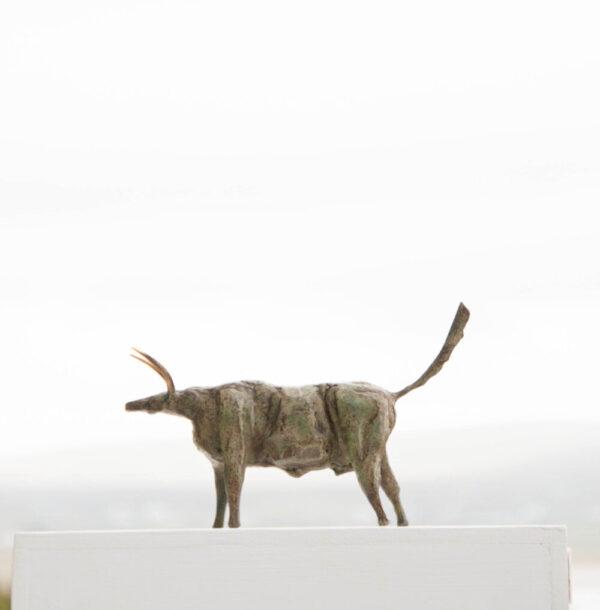 Painted steel bull sculpture