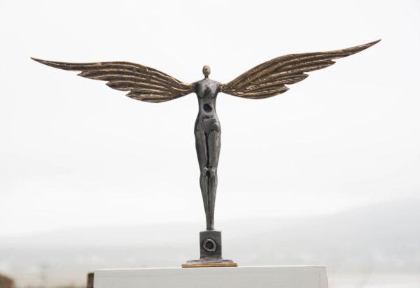 Polished steel & brass figure
