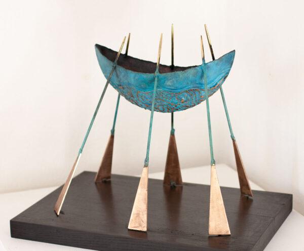 Bronze boat sculpture