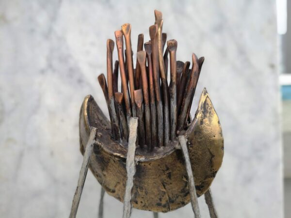 Brass, copper boat sculpture